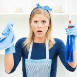 how to treat mould shocked woman cleaning