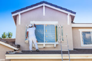contractor painting outside home