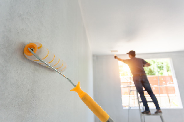 interior painting roller worker background home remodeling